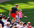 Baltimore Orioles fans dancing on dugout (7356646332).jpg
