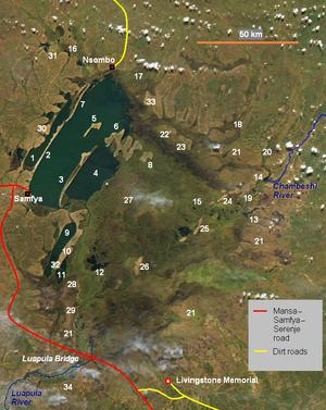 Lake Bangweulu - Satellite photograph of Lake Bangweulu (upper left) and the Bangweulu Swamps (centre). Water shows as dark green. Key: 1 Lake Chifunabuli, 2 Ifunge Peninsula, 3 Mbabala Island, 4 Lake Walilupe, 5 Chishi Island, 6 Chilubi Island, 7 Ifunge Mwenzi Island, 8 Nsumbu Island, 9 Lake Kampolombo, 10 Kapata Peninsula, 11 Lake Kangwena, 12 Lake Chali, 13 Lake Chaya, 14 Lake Wumba, 15 Pook Lagoon, 16 Lupososhi Estuary, 17 Luena Estuary, 18 Lukuto Estuary, 19 Chambeshi Estuary, 20 Luansenshi River, 21 Grassy floodplains, 22 Chichile Island, 23 Kasansa Island, 24 Panyo Island, 25 Nsalushi Island, 26 Ncheta Island, 27 Lunga Bank, 28 Kasenga, 29 Kataba, 30 Lubwe, 31 Kasaba, 32 Twingi, 33 Chaba, 34 Congo Pedicle. Satellite image credit: Jeff Schmaltz, MODIS Rapid Response Team, NASA/GSFC