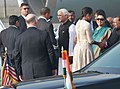 Barack Obama and the First Lady Mrs. Michelle Obama being seen off by the Minister of State (Independent Charge) for Corporate Affairs and Minority Affairs, Shri Salman Khurshid, at Palam Airport, in New Delhi.jpg