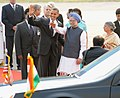 Barack Obama and the First Lady Mrs. Michelle Obama with the Prime Minister, Dr. Manmohan Singh and his wife Smt. Gursharan Kaur, on their arrival, at Palam Air Force Station, in New Delhi on November 07, 2010 (1).jpg