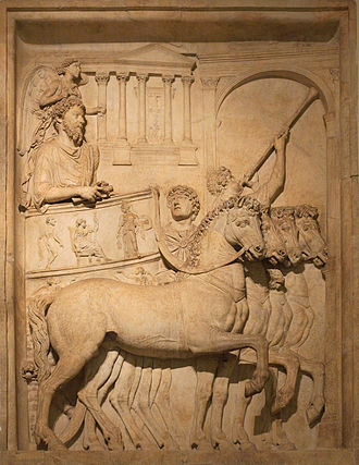 Roman triumph - Panel from a representation of a triumph of the Emperor Marcus Aurelius; a winged genius hovers above his head.