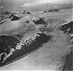 Bear Glacier, valley glacier with bergschrund, and icefield in the background, September 4, 1977 (GLACIERS 6830).jpg