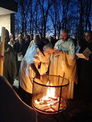 Easter Fire - Benedictine monks preparing to light the Christ candle prior to Easter Vigil mass, Morristown, New Jersey