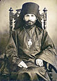 Bishop Aleksandr Aleksandr Aleksandrovich Nemolovsky seated wearing bishops hat.jpg