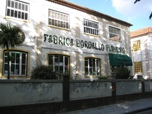 Bordallo Pinheiro ceramics factory. Two stories. Large windows.