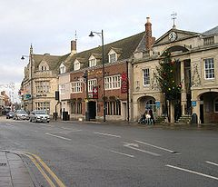 Historic town centre, showing the town hall (with traditional Christmas tree), Burghley Arms and Lloyds Bank, all Victorian rebuilds of medieval originals