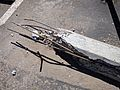 Broken concrete parking chock with exposed rebar.jpg
