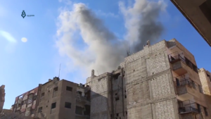 Qaboun offensive (2017) - Smoke rises from a building in Jobar after being hit by a bomb during the rebel counter-offensive.