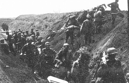 German soldiers move along an anti-tank ditch, while combat engineers prepare charges to breach it. Bundesarchiv Bild 101III-Cantzler-077-39, Russland, Angehorige der Waffen-SS in einer Stellung.jpg