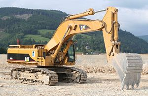 Hydraulic machinery - An excavator; main hydraulics: Boom cylinders, swingdrive, cooler fan and trackdrive
