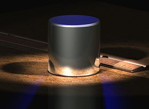"Shown above is a computer-generated image of the International Prototype Kilogram (""IPK""). The IPK is the kilogram. It sits next to an inch-based ruler for scale. The IPK is made of a platinum-iridium alloy and is stored in a vault at the BIPM in Sèvres, France. For other kilogram-related images, see Links to photographs, below."