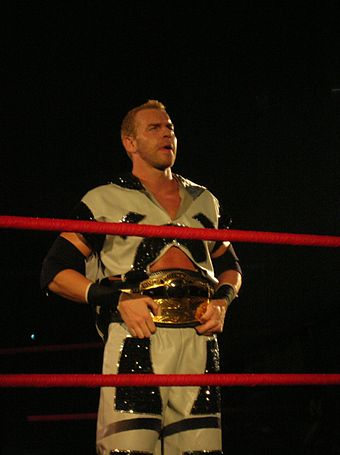While with TNA, Christian became a two-time NWA World Heavyweight Champion Cage Champ.jpg