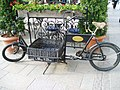 Cargo bicycle parked outside restaurant Main Square Krakow POLAND May 2006.jpg