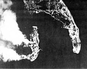 Naval Station Sangley Point - A Japanese air raid on 10 December 1941 leaves the Cavite Navy Yard in flames.