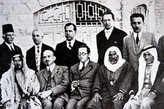 Yitzhak Ben-Zvi - Yitzhak Ben-Zvi (standing, second from right) at a meeting with Arab leaders at the King David Hotel, Jerusalem, 1933. Also pictured are Chaim Weizmann (sitting, second from left), Haim Arlosoroff (sitting, center), and Moshe Shertok (Sharett) (standing, right).