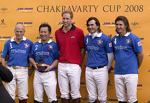 Polo shirt - Polo players Paul Barr, Vichai Srivaddhanaprabha, Adolfo Cambiaso, Martin Valent with fellow player Prince William (center), wearing polo shirts as part of their uniform.