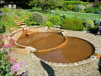 Chalice Well - The seven bowls flow to form a vesica piscis-shaped pool