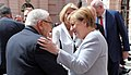 Chancellor Merkel greets Henry Kissinger (35278507082).jpg