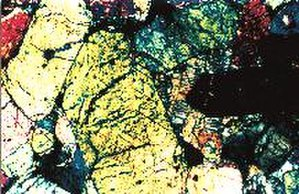 Chassigny (meteorite) - Thin section of Chassigny under cross-polarized light (JPL)