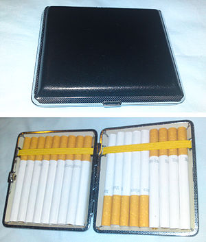 Cigarette case - A cigarette case covered in black leather with silver trim, showing the outside and the inside filled with cigarettes.
