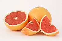 This photograph shows two pink grapefruits (Ci...