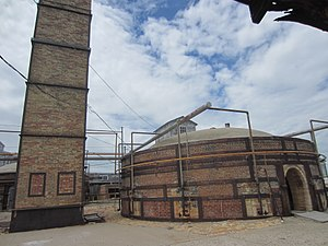 Claybank Brick Plant -  Exterior of down-draft kiln. Each kiln held 300,000 bricks and was loaded and unloaded by hand. Initially kilns were fueled by coal, but were converted to gas in the 1960s. Each batch took a week to load, a week to fire, and a week to cool.