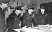 Cochrane, Gibson, King George VI and Whitworth discussing the Dambusters Raid
