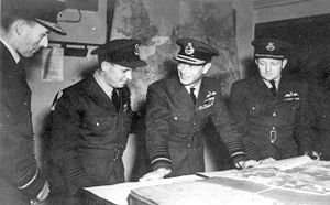 Operation Chastise - Air Vice-Marshal Ralph Cochrane, Wing Commander Guy Gibson, King George VI and Group Captain John Whitworth discussing the Dambuster Raid in May 1943