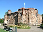Colchester Castle keep (including excavated remains of forebuilding in moat)