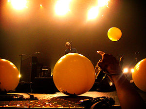 "Yellow (Coldplay song) - Coldplay performing ""Yellow"" in 2006 during the Twisted Logic tour, with yellow balloons falling"