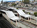 Colma station from parking garage, March 2018.JPG