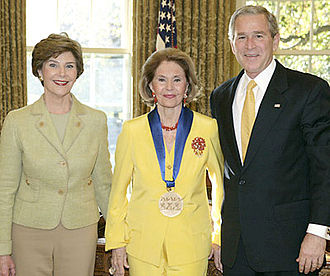 Cyd Charisse - Charisse with George W. and Laura Bush, accepting the National Medal of Arts and Humanities Award in 2006. Photo by Paul Morse