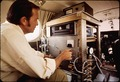 DR. JAMES N. PITTS, DIRECTOR OF AIR POLLUTION RESEARCH CENTER WITH MONITORING EQUIPMENT INSIDE NASA - NARA - 542668.tif