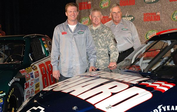 Dale Earnhardt Jr. stands with Lt. Gen. Clyde A. Vaughn, director of the Army National Guard, and team owner Rick Hendrick. DaleNumber88Announcement.jpg