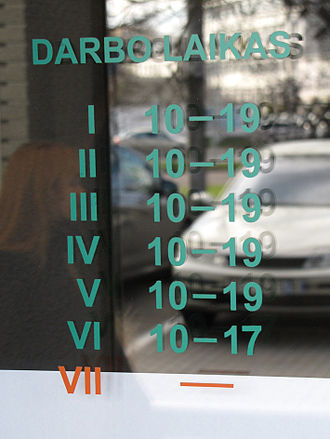 Roman numerals - Business hours table on a shop window in Vilnius