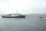 Decommissioned USS Fort Snelling (LSD-30) is towed on the James River in 1989.jpeg