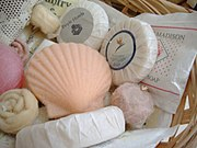 A collection of decorative soaps used for human hygiene purposes. This type of soap is typically found inside hotels.