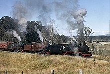 Queensland Rail heritage locos of the PB15, C17 and BB18¼ classes haul a special train for the 125th anniversary of QR on the Little Liverpool Range, west of Grandchester, July 1990.