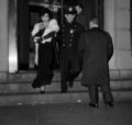 Drag queen arrested in a bar raid 1962.png