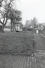Drummond Street, Dundee The track of the 1830s Dundee to Newtyle Railway ran up an incline between the line of trees and the road on the right towards the tunnel - the entrance of the tunnel was under the church seen in the distance.