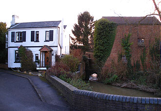 River Leam - The millstream at Eathorpe with the abandoned mill to the right and Millhouse to the left