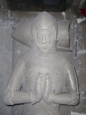 """Maurice de Berkeley, 4th Baron Berkeley - Restored effigy of Maurice de Berkeley, 4th Baron Berkeley, """"The Valiant"""", in St Augustine's Abbey (now Bristol Cathedral), founded by his ancestor. Adjacent at his right hand is the effigy  of his mother Margaret Mortimer(died 1337). The arms of Berkeley are shown on his tunic. His head rests on his helm atop which is visible the crest of Berkeley a bishop's mitre"""