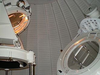 Einstein Tower - Zeiss-type Coelostat in the dome of the Einstein Tower. On the right is the heliostat. On the left, a mirror which reflects the beam of light down the tower. The mirrors were covered with protection caps when the photo was taken.