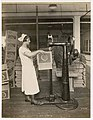 Employee operating carton stapling machine at Crescent Manufacturing Company, Seattle, circa 1923 (MOHAI 8593).jpg