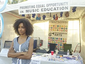 Spalding operating a music education booth at Austin City Limits Music Festival, 2012 Esperanza Spalding at the Anthropos Arts booth at ACL Fest (8220455009).jpg