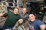 Expedition 57 crew members gather inside the Zvezda Service Module.jpg