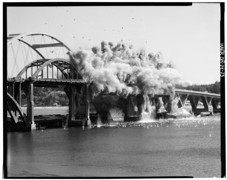 Explosion of charges on two of the three tied arches, looking southeast - Alsea Bay Bridge, Spanning Alsea Bay at Oregon Coast Highway, Waldport, Lincoln County, OR HAER ORE,21-WALPO,1-23