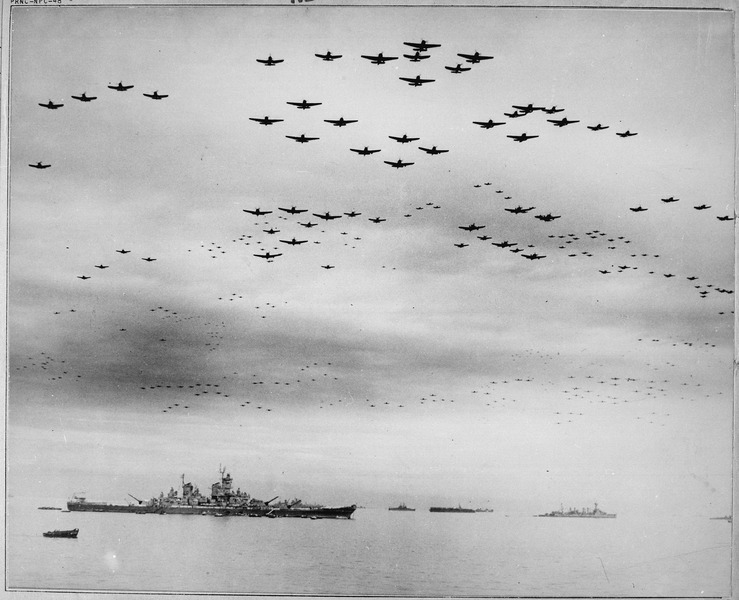 F4U's and F6F's fly in formation during surrender ceremonies, Tokyo, Japan. USS MISSOURI (in) left foreground. - NARA - 520775