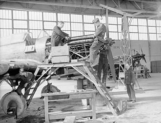 Fairey Battle - Mechanics of No. 226 Squadron RAF overhaul the engines of their Battles in a hangar at Reims, France
