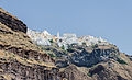 Fira and crater rim seen from the caldera - Santorini - Greece - 05.jpg